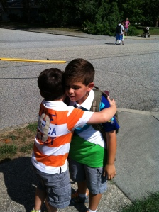Finn clinging to Charlie on the first day of school.