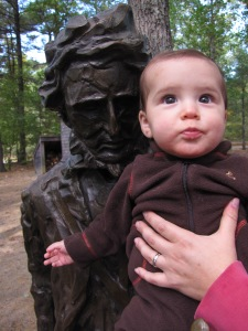 Henry at Walden Pond with the statue of his namesake Henry David Thoreau.