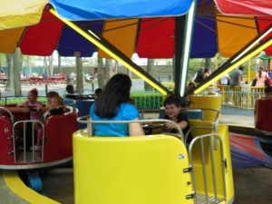 "Riding the ""teacups"" or whatever you call them. I'm sure it was no coincidence they were in the yellow one!"